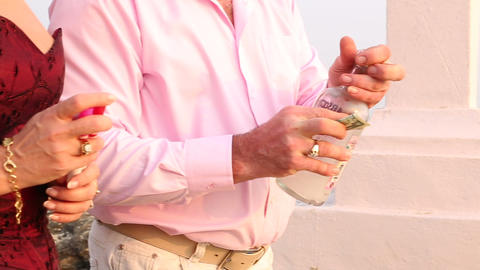 a man and a woman put a dollar in a bottle Stock Video Footage
