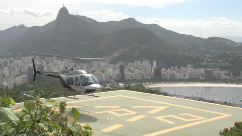 004 Rio , Helicopter arrives at platform above Rio Stock Video Footage