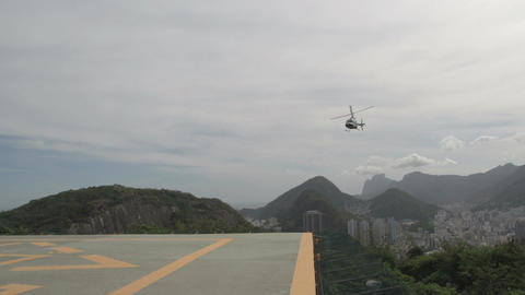 008 Rio , Helicopter arrives at platform above Rio Footage