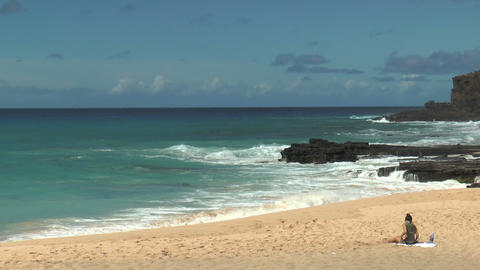 woman relaxing at kaupo beach,oahu,hawaii Stock Video Footage
