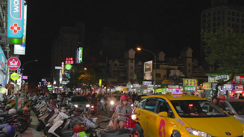 Ruifeng night market and masked women in scooters Footage