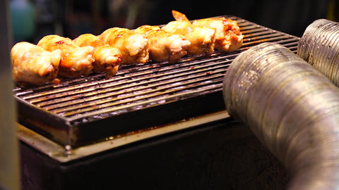 Ruifeng night market - close-up of food being gril Stock Video Footage