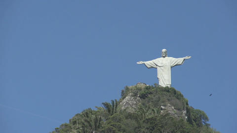 065 Rio , Christ the Redeemer on blue sky Stock Video Footage