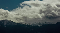 Clouds Mist Fog And Snow On Mountain Timelapse stock footage