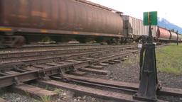 HD2008-6-7-11 hopper mixed train leaving slow Stock Video Footage