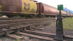 HD2008-6-7-11 hopper mixed train leaving slow Footage