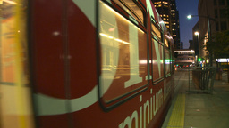 HD2008-6-8-20 dusk Calgary DT LRT leaves stn Stock Video Footage