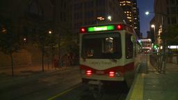 HD2008-6-8-20 dusk Calgary DT LRT leaves stn Stock Video Footage