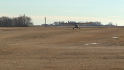 HD2008-3-1-2 light aircraft landing on grass strip Stock Video Footage