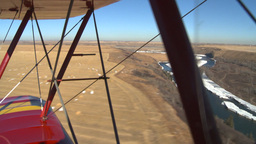 HD2008-3-1-16 Red biplane aerial wing left river Stock Video Footage