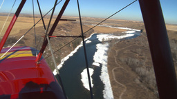 HD2008-3-1-16 Red biplane aerial wing left river Footage