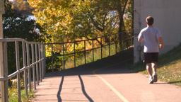HD2008-10-1b-1 runner on bike path autumn Stock Video Footage