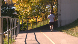 HD2008-10-1b-1 runner on bike path autumn Stock Video Footage