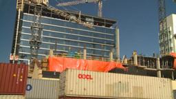 HD2008-10-4-10 construction crane tilt dn to intermodal Stock Video Footage