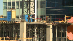 HD2008-10-4-16 construction workers on bdg Stock Video Footage