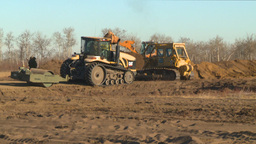 cat dozer and tractors working field Footage