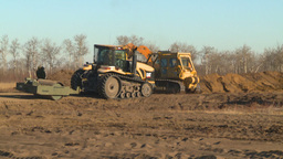 cat dozer and tractors working field Stock Video Footage