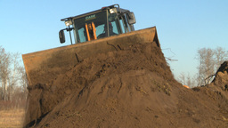 HD2008-10-10-2 Front end loder dirt pile Stock Video Footage