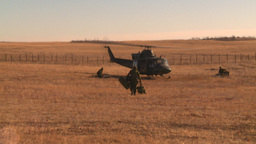HD2008-10-11-3 heli idle troops out Stock Video Footage
