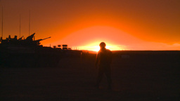 silou LAV sunset soldier walks by Stock Video Footage