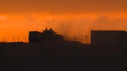 HD2008-10-11-23 silou LAV sunset truck dusty Stock Video Footage