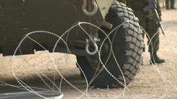 HD2008-10-16-1 razor wire boots and LAV3 Stock Video Footage