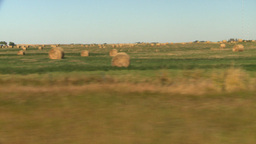 HD2008-9-3-45 drive wheat fields hay rolls Stock Video Footage