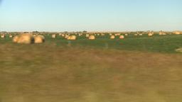 HD2008-9-3-47 drive wheat fields hay rolls Stock Video Footage