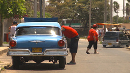 HD2009-4-7-31 Cuba old car repair street Stock Video Footage