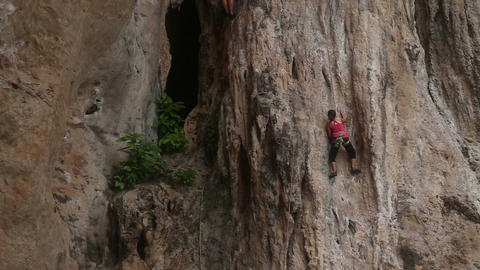climber climbing a cliff with insurance Stock Video Footage