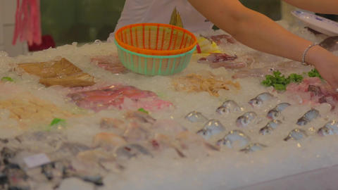 Cijin Island - lady handpicks fresh seafood Stock Video Footage