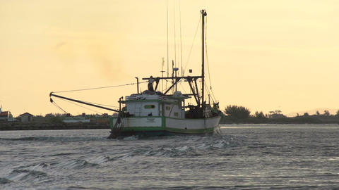 001 Laguna , Fishingboat passing by at sunset Footage