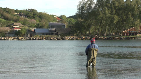 024 Laguna , fisherman stand at in shallow waters  Footage