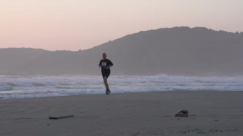 034 Laguna , Woman running at the beach , sunrise Stock Video Footage