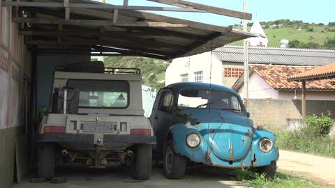 077 Laguna , small village , old cars in garage Footage