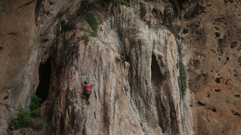 climber climbing a cliff with insurance Footage