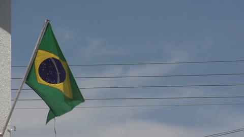 0143 Flag of Brazil on building , bleu sky , elect Footage