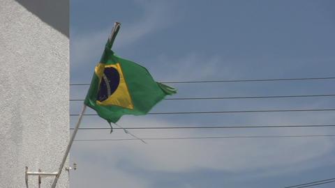 0144 Flag of Brazil on building , bleu sky , elect Footage