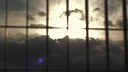 Clouds Lightrays Sunrise Behind Steel Gate stock footage