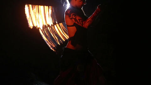 Artist turns the fire fans performance Footage