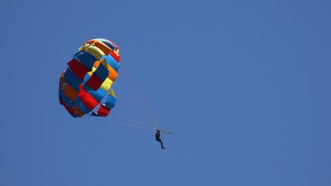 Parachutist Crosses The Screen stock footage