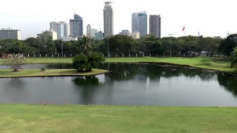 golf course cityscape pan shot Footage