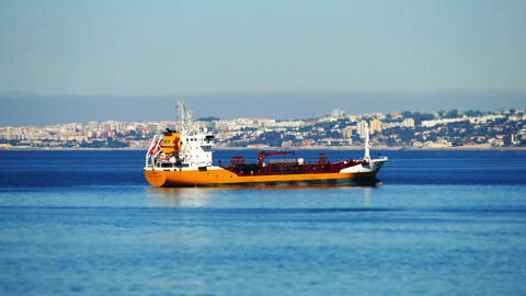 Cargo Ship Anchored Near Port Lisbon stock footage