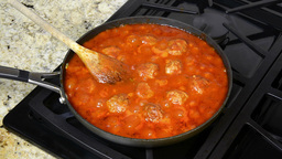 Simmering meatballs in Spaghetti sauce Footage