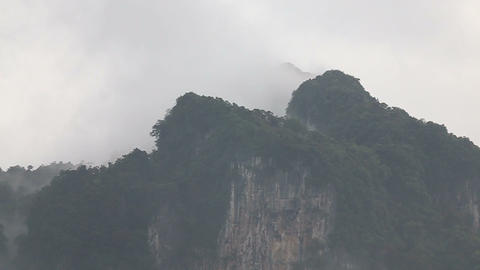 clouds float of tropical mountains Footage