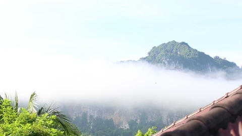 clouds float of tropical mountains Stock Video Footage