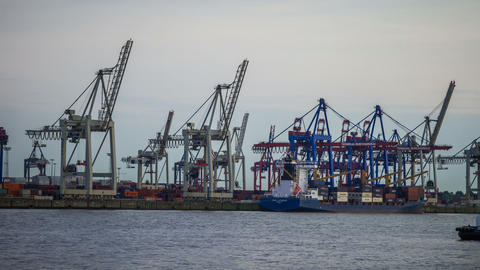 ship is unloaded - Hamburg harbor in the evening - Stock Video Footage