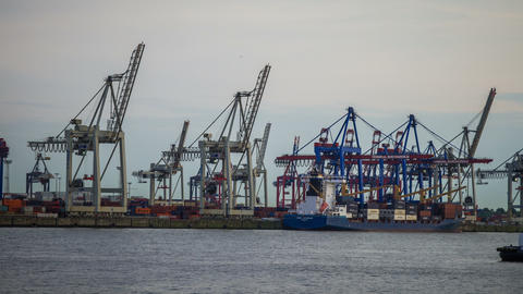 Ship Is Unloaded - Hamburg Harbor In The Evening - stock footage