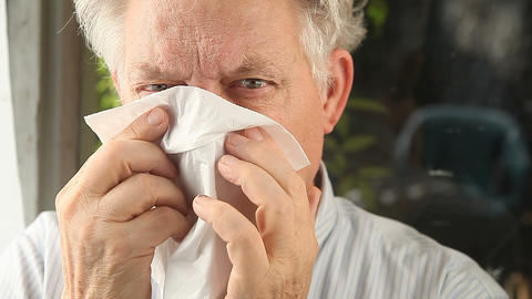 man blowing nose Stock Video Footage