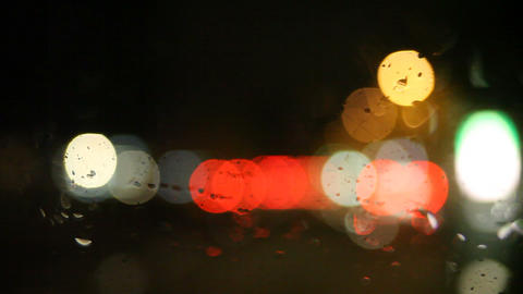 rain on windshield with bokeh Stock Video Footage
